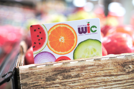WIC Card leaning on fruit